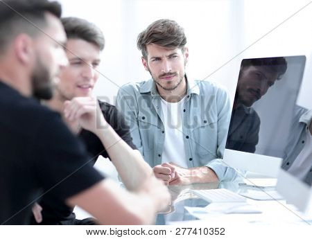Beautiful business people are using computers while working in o