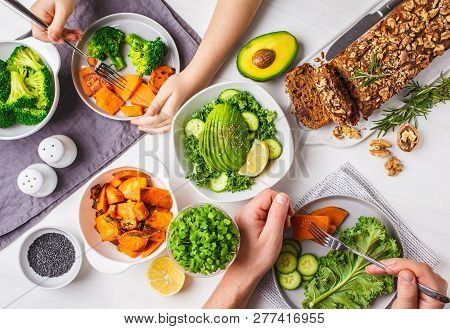 Healthy Vegan Food Lunch, Top View. Vegetarian Dinner Table, People Eat Healthy Food. Salad, Sweet P