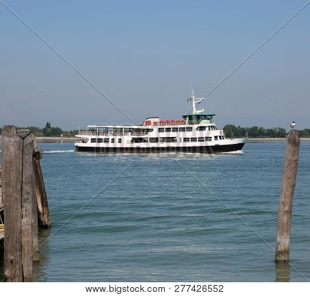 Venetian Water Bus Also Called Vaporetto In Italy To Transport Tourists To Venice While Mooring At T