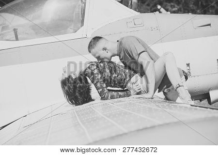 Couple Makes Love On Wing Of Old Plane On Sunny Day. Couple In Love Full Of Desire Have Sex Near Air