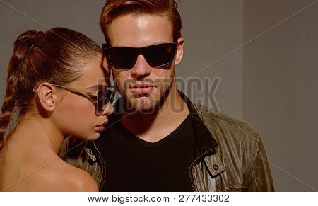 Exciting Style. Couple Of Man And Woman Wear Fashion Glasses. Fashion Models In Sun Glasses. Couple