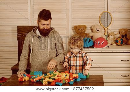 Father And Small Child Play With Constructor. Happy Family And Childrens Day. Happy Childhood. Care