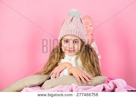Kid Girl Wear Knitted Hat Relaxing Pink Background. Child Long Hair Warm Woolen Hat Enjoy Warm. Warm