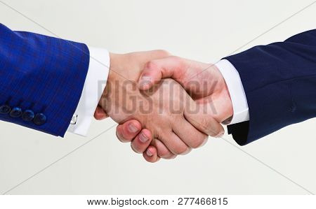 Shaking Hands At Meeting. Friendly Handshake Gesture. Handshake After Signing Profitable Agreement.