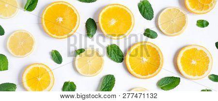 White Background With Lemon, Orange Slices And Mint. Concept With Fresh Fruit. Lemon, Orange, Mint.
