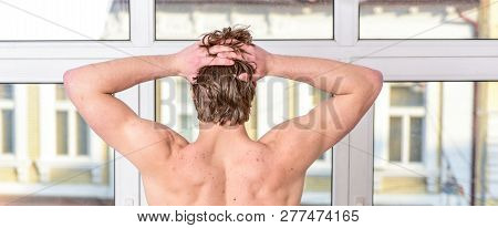Feeling good. Pleasant morning relaxation. Enjoy morning begin awesome day. Macho relaxing in morning bedroom. Macho sexy muscular torso guy relaxing near window bedroom. Health and wellbeing concept poster