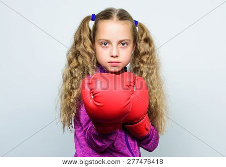 Girl Cute Child With Red Gloves Posing On White Background. Cute Kid With Sport Boxing Gloves. Boxin