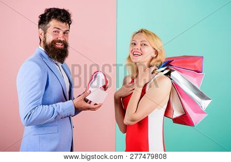 Ask Man To Purchase Lots Presents For Girlfriend. Couple With Luxury Bags In Shopping Mall. Couple E