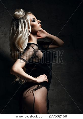 Young sexy blonde fashion woman lying on floor in black body cloth and choker  and leather spring  jacket on dark night  light background poster