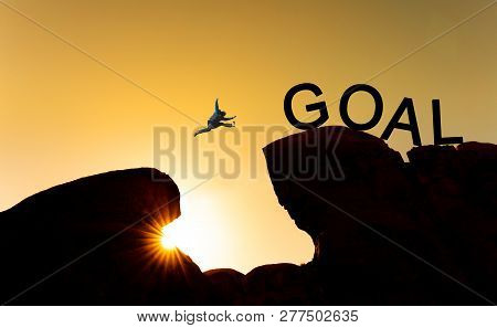 Silhouette A Man Jumping Over Precipice To Goal. Achieve Goal, Business Goals, Challenge And Success