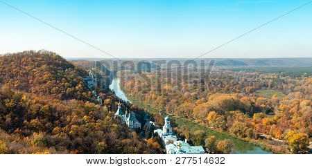 Monastery On Hill, Ukraine. Nature Panoramic Landscape. Narrow River Flowing Between High Hills Cove