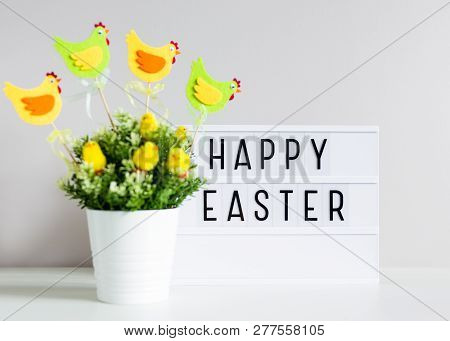 Vintage Lightbox With Happy Easter Greetings And Flowerpot On The Table