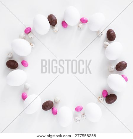 Easter Background - Close Up Circle Frame By Eggs And Sweets Over White
