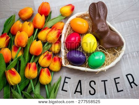 Easter Concept - Top View Of Colorful Easter Eggs, Chocolate Bunny And Flowers