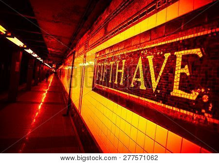 Mosaic Sign At The Fifth Avenue Subway Station In Manhattan. Image In Dramatic Dark Red Tonality