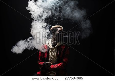 Young Man Holding And Vaping An Electronic Cigarette, E-cig, Ecigarette.