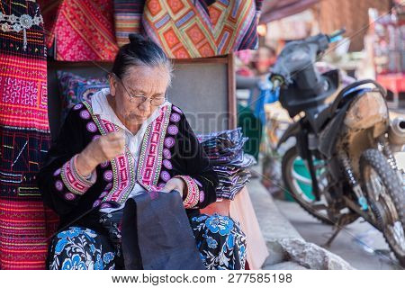 Hmong Hill Tribe Village, Chiang Mai - Thailand, January 6, 2019 : Hmong Hill Tribe Working Embroide