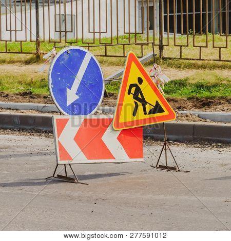 Work In Progress. Roadworks, Road Signs. Men At Work. Some Signs Signage For Work In Progress On Urb