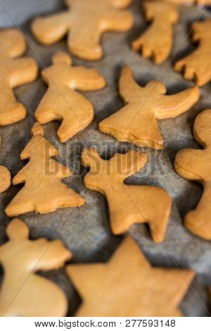 Winter Concept - Close Up Of Shaped Cookies Or Gingerbreads In Hot Oven