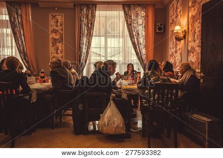 Kyiv, Ukraine - Jan 7: Restaurant With Poor People Having Lunch At The Christmas Charity Dinner For