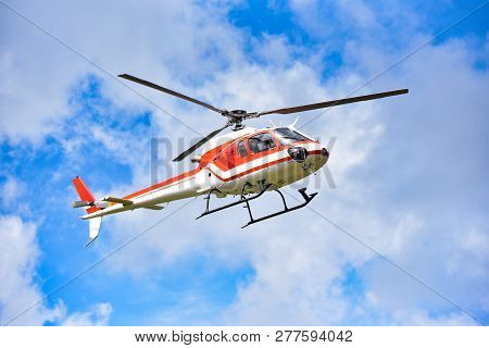 Helicopter Flying On Sky / White Red Fly Helicopter On Blue Sky With Clouds Good Air Bright Day  - H