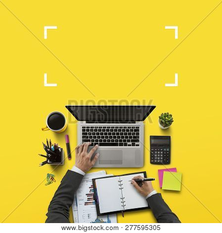 Office Workplace With Laptop, Notebook, Hand, Office Supplies, On Yellow Background. Solution, Busin