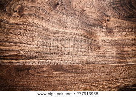 Walnut Wooden Cutting Board With Vignette Shot From Above In Flat Lay Position.