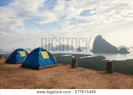 Camping Tents On A Seashore In A Morning Light With View On Sea And Rocks