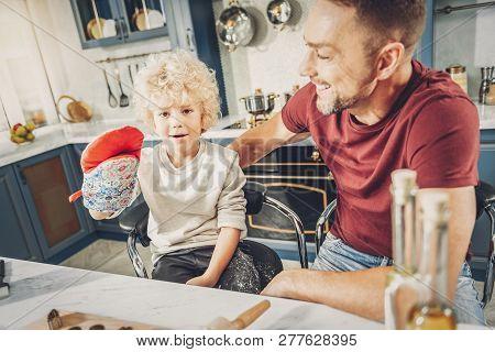 Joyful Jovial Boy Making Fun With Glove