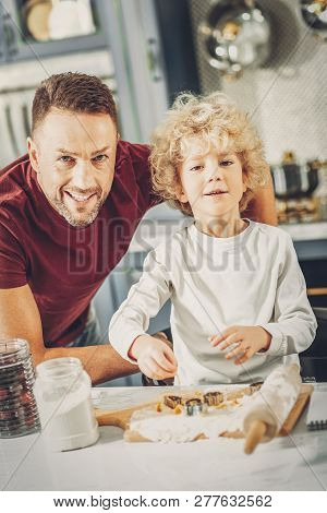 Jovial Jolly Man And Boy Striving In Baking