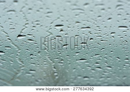 Water Drops On Front Glass Of Car, Rainy Day