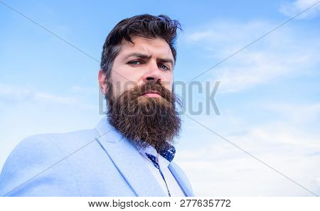 Expert tips for growing and maintaining mustache. Hipster serious handsome attractive guy with long beard. Ultimate mustache grooming guide. Man bearded hipster with mustache blue sky background poster