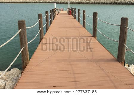 Wooden Port With Rope On Water, Vessel