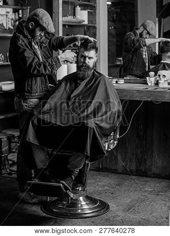 Hipster Client Getting Haircut. Barber With Clipper Trimming Hair On Temple Of Client. Hipster Lifes