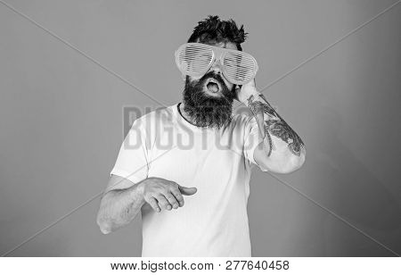 Man Bearded Hipster Wears Giant Louvered Sunglasses. Hipster Wears Shutter Shades Sunglasses. Sungla