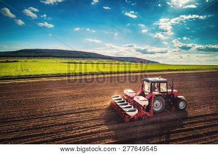 Farmer In Tractor Preparing Farmland With Seedbed For The Next Year, Aerial Drone View