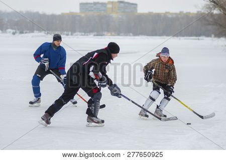Dnipro, Ukraine - January 28, 2018: Group Of Active People Playing Hokey On A Frozen River Dnipro In