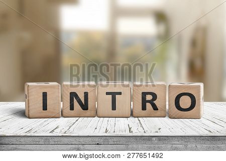Intro Sign Made With Wooden Cubes In A Bright Room On A Table
