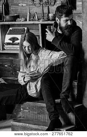 Couple Spend Pleasant Evening With Book And Mulled Wine, Wooden Interior Background. Girl And Man On
