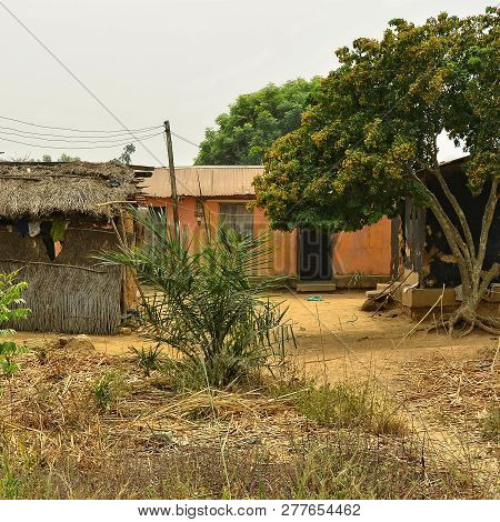 Usual Rural House And A Barn With Thatched Roof In West African Village. Countryside. African Yard.