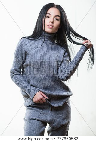 Warm comfortable clothes. Casual style fashion for every day. Female knitwear. Fashionable knitwear. Knitwear concept. Feel warm and comfortable. Woman wear grey textile suit blouse and pants poster