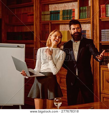 Buy Online Concept. Happy Couple Buy Online On Shop Website. Sensual Woman And Bearded Man Use Lapto