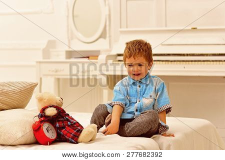 Little Boy Playing With Bear. Happy Family And Childrens Day. Happy Childhood. Care And Development.