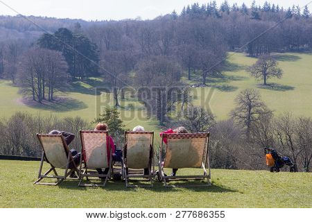 Grandparents Day Out. Pensioners On Vacation In The Countryside. Four Elderly People Sitting On Deck