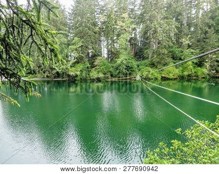 The West Coast Trail Cable Car Or Trolley Passing Over A Beautiful Green Turquoise River.  This Is A