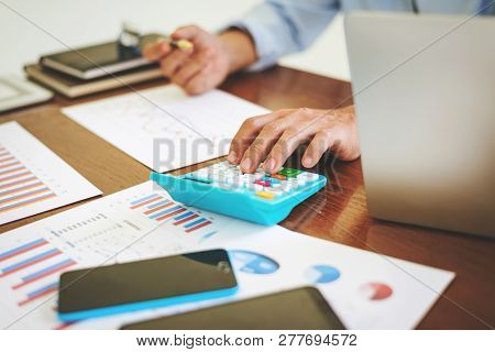 Accountant Calculating Tax Expense Financial Statement, Business Man Working Hard Alone In The Offic