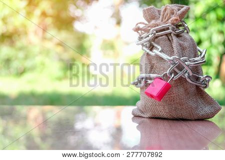 Full Sack Locked With Chain And Red Key. Responsibility For Tax And Liability - Businessman Corporat