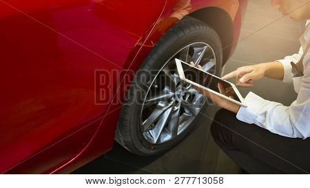 Asian Man Car Inspection Holdind Tablet For Measure Quantity Inflated Rubber Tires Car.close Up Hand