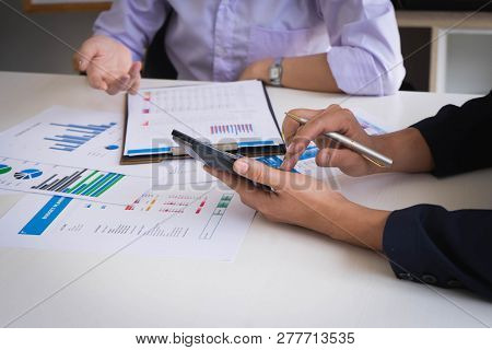 Business People Meeting To Analyze And Discuss The Situation On The Financial Report In Meeting Room