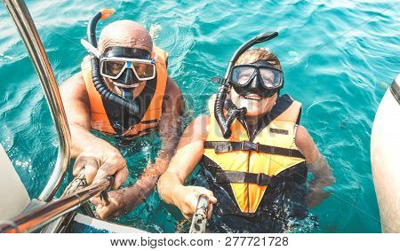 Retired Couple Taking Happy Selfie In Tropical Sea Excursion With Life Vests And Snorkel Masks - Boa